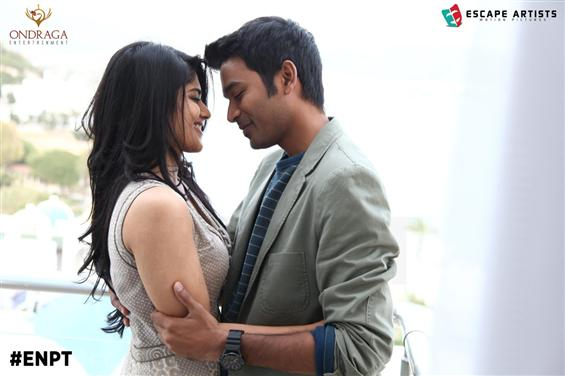 Enai Nokki Paayum Thotta movie stills - Tamil Movie Poster