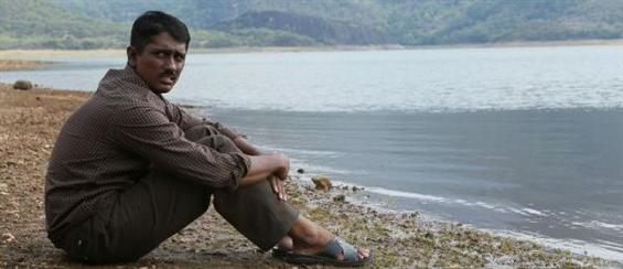 Enakkul Oruvan gets tax exemption - Tamil Movie Poster