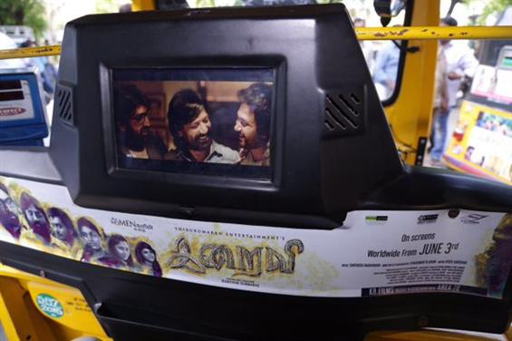 Iraivi team's unique promotional strategy on autos - Tamil Movie Poster
