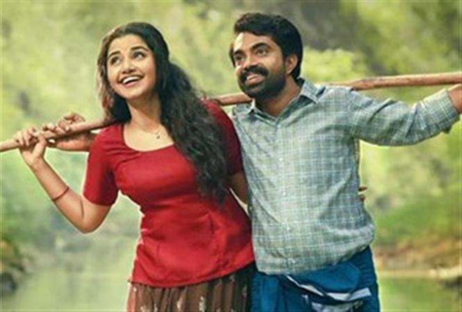 Maniyarayile Ashokan review - A simple yet twisted story of a mediocre man and his peculiar marriage life!